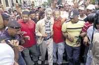 Movilización internacional repudia desalojos violentos en Santo Domingo